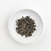 Green tea leaves (Gu Zhang, China) on plate