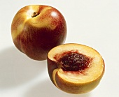 Whole and half nectarine, variety 'Tom Grano'