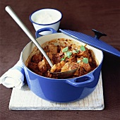 Spicy pork ragout in casserole