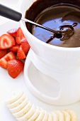 Chocolate fondue with strawberries and bananas