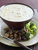 Cheese fondue with mushrooms and broccoli