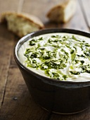 Cheese sauce with basil oil and white bread