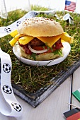 Burger with national flags on small football pitch
