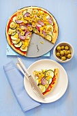 Courgette and pepper pizza with olives