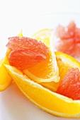 Oranges wedges and pink grapefruit flesh