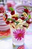 Cheese and strawberries on cocktail sticks with fresh mint