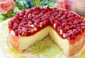 Wild strawberry cheesecake, a piece removed
