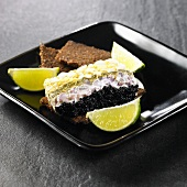 Terrine of caviar, avocado, soft cheese and egg on pumpernickel