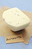 Boschetto cheese (Italian semi-hard cheese with truffle) on paper