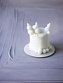 Small white cake with fondant decorations