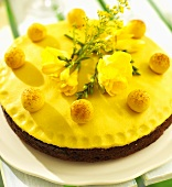 Simnel cake with yellow freesias for Easter