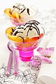 Vanilla ice cream with chocolate sauce and nectarines