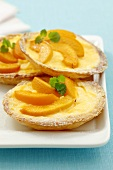 Peach tarts with vanilla custard