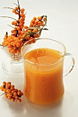 Sea buckthorn drink and fresh sea buckthorn berries