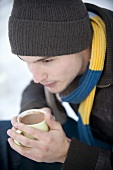Young man drinking hot cocoa