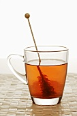 Cup of tea with sugar swizzle stick