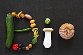 The word 'BIO' written in vegetables, mushrooms, fruit and nuts
