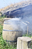 Meat being smoked in wooden barrel in Viking village