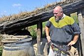 Man in Viking costume smoking meat