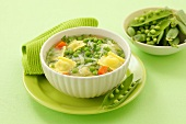 Green minestrone with peas and ravioli