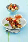 Chicken and cherry tomato kebabs with tomato sauce
