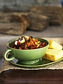 Chili in a Green Bowl with Cornbread