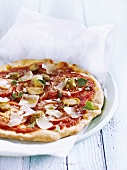 Tomato pizza with green olives and Parmesan