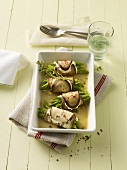 Aubergine roulade with beans and sheeps' cheese