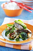 Beef with soba noodles, broccoli, ginger and sesame