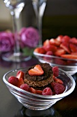 Baked chocolate pudding with fresh berries