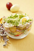Potato salad with turkey fillet, gherkins, eggs and cress