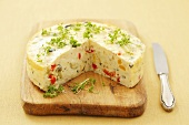 Savory cheesecake with vegetables, herbs and cress