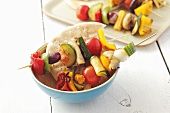 Barbecued vegetable skewers with pita bread