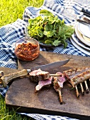 Barbecued rack of lamb (partly sliced) with tomato compote