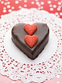 Small chocolate cake with sugar hearts