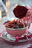 Hot berries with chocolate sauce for Valentine's Day