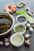 Asian seafood fondue with three dips