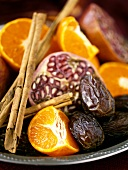 Mandarin oranges, dates, pomegranate and cinnamon sticks