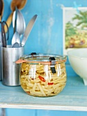Candied horseradish in a preserving jar