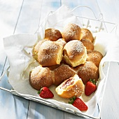 Buchteln (baked, sweet yeast dumpling) with a strawberry filling