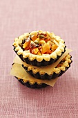 Puff pastry tartlets with apples, apricots, nuts and honey