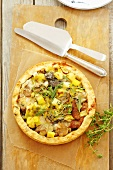 Leek and mushroom tart with herbs, seen from above
