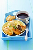 Yeast dough parcels stuffed with lentils and borscht (beetroot soup)