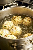 Boiling Tyrolean bacon dumplings in water