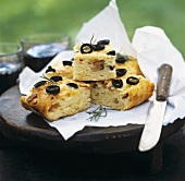 Potato bread with ham and olives