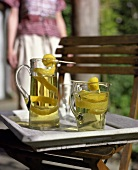 Home-made lemonade in jug and glass
