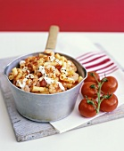 Macaroni with tomatoes and shrimps in a pan