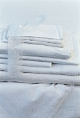 A pile of white tablecloths