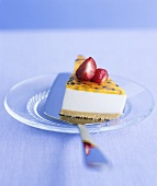 A piece of passion fruit and strawberry cheesecake