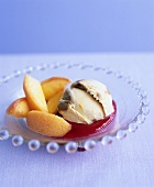 Poached peaches with ice cream on raspberry sauce